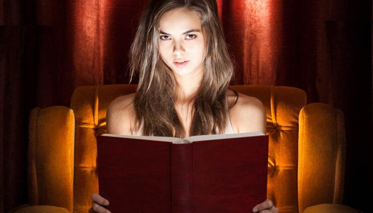 spooky girl reading a horror novel